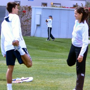 Friday - Djokovic and Ivanovic jog and stretch before practicing